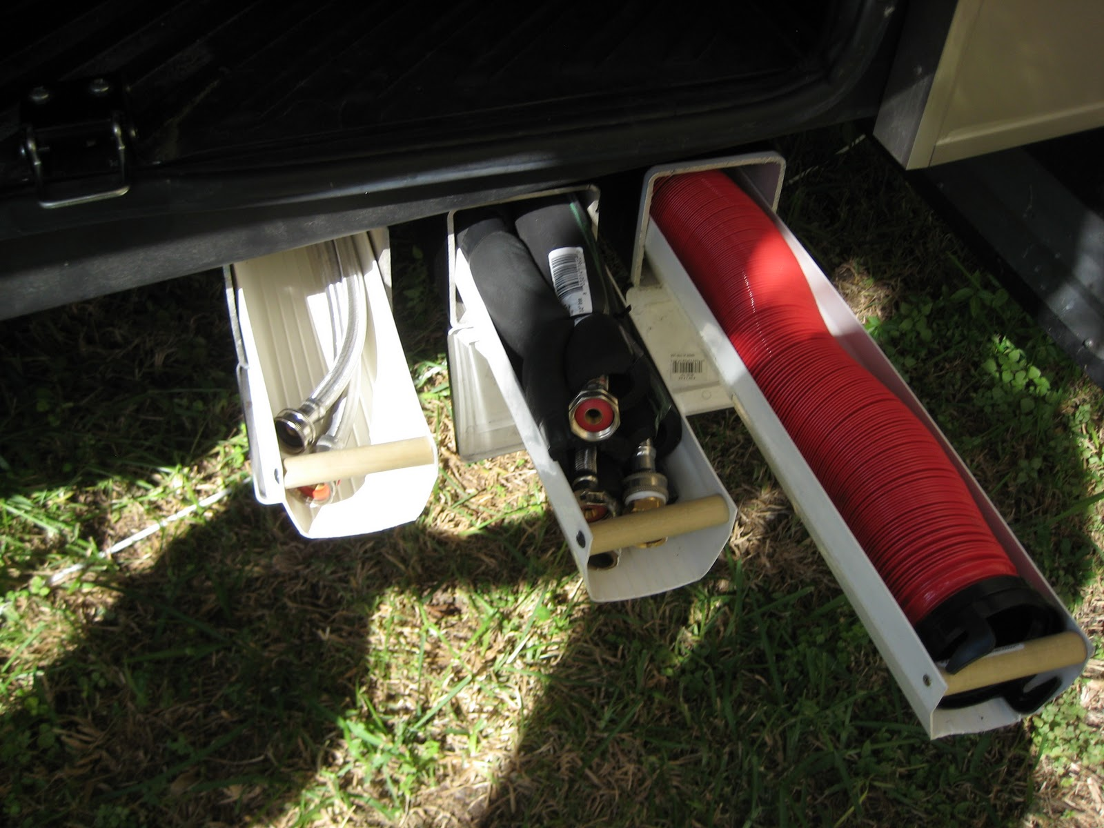 Rv mods sewer hose storage ideas and examples for Camper storage