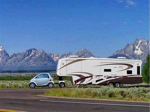 smart car towing a fifth wheel