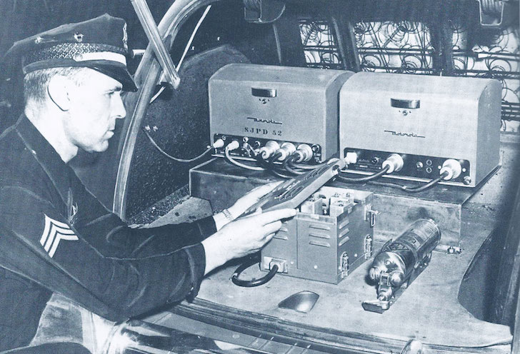 Patrol vehicle's radio equipment in 1950. Sgt. Terry Blackwood featured
