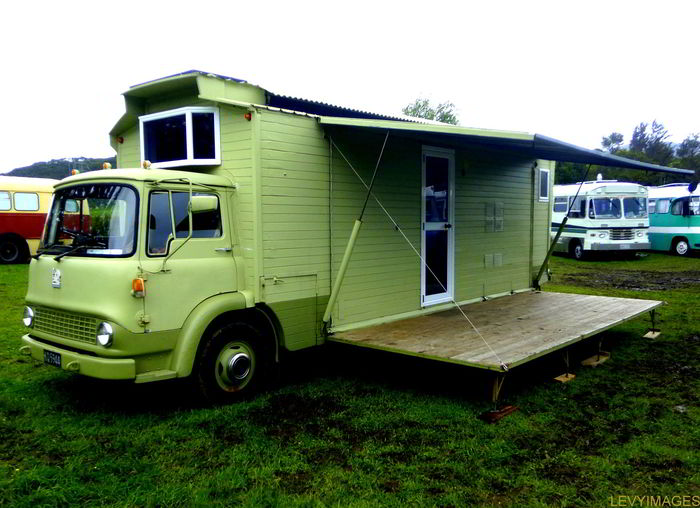 Eye catching custom built vintage caboose rv with a fold for Rv decks