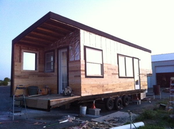 Stunning tiny house built on a gooseneck flatbed trailer for Small homes built on trailers