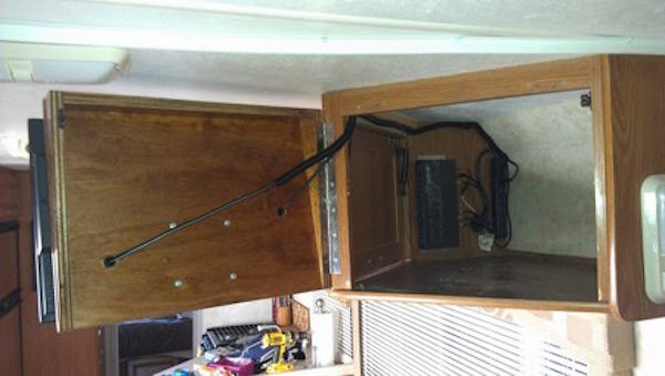 Swap Out A Bulky Rv Bedroom Tv For Additional Storage