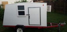 DIY Mini Camper Built from Plywood and Fiberglass