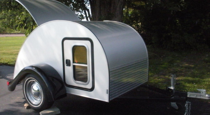 Slick Tear Drop Camper With Chrome Rims and Moon Hubcaps. Built by a Pro.