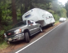 Quick Thinking And Good Luck Saved This GMC Truck And Fifth Wheel Trailer From Tumbling Into A Ditch