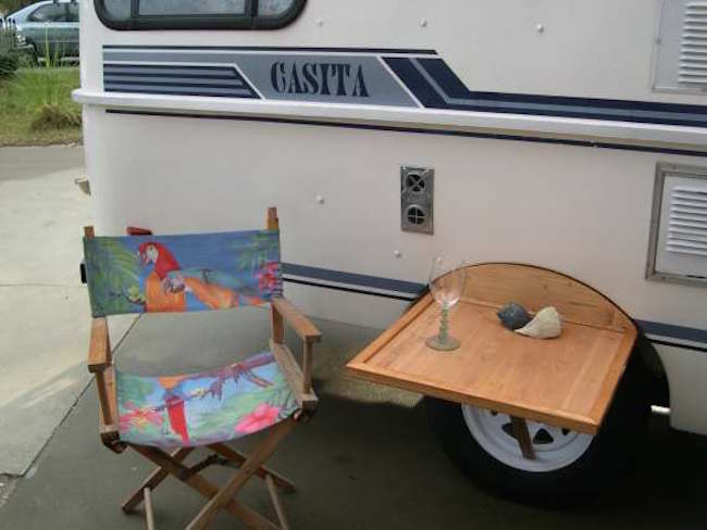 outdoor table fits between wheel well and tire on casita. Black Bedroom Furniture Sets. Home Design Ideas