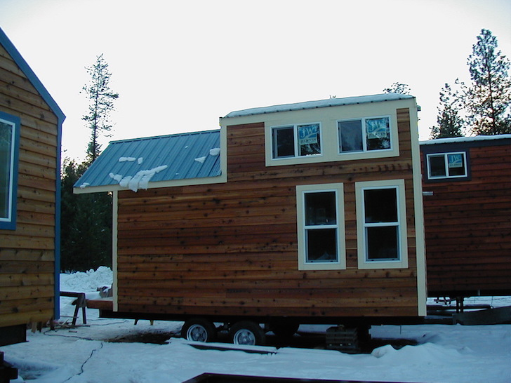 This mobile tiny house looks like a cabin inside and out for House look from outside