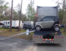 This Is How You Unload A Smart Car From Your Semi Truck At The RV Park
