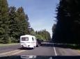Merging Driver Pulling Fiberglass Camper Nearly Runs RVer Off Road
